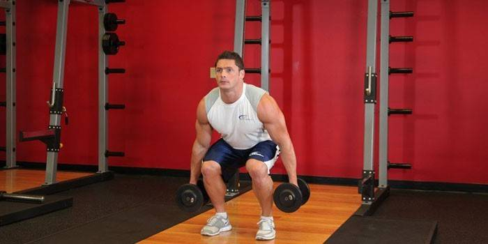 Присідання з гантелями для м'язів сідниць і ніг для чоловіків і дівчат
