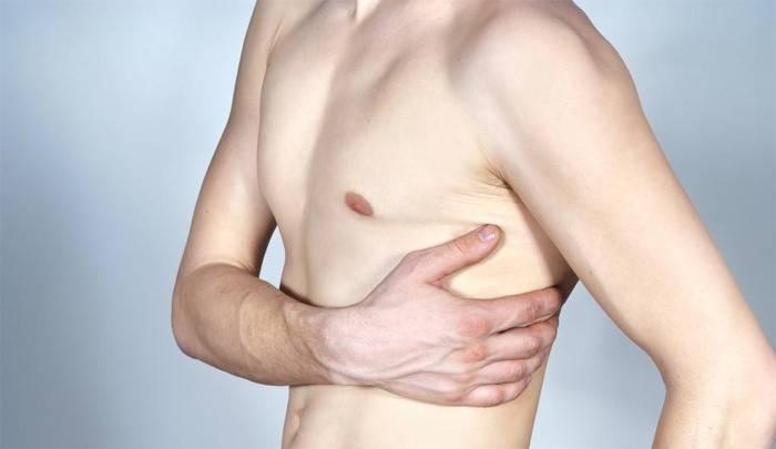 Біль під лівим ребром спереду: причини і лікування ниючих і різких відчуттів