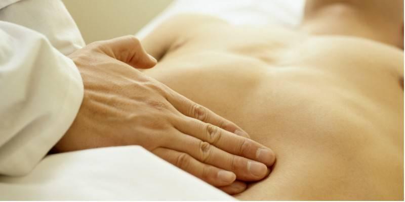 Болі внизу живота у чоловіків: причини симптому